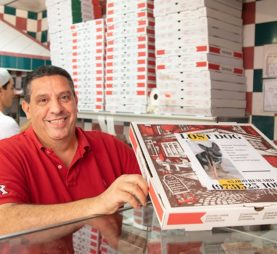 Giovanni Sanfratello with a pizza box with a lost dog flyer on it