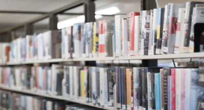 Countless books on floors to ceiling shelves in a Rutgers library