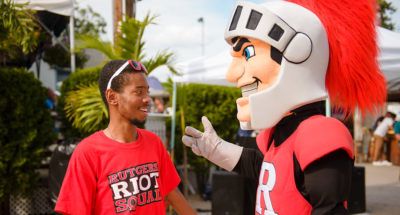 "Scarlet Knight and Rutgers Alumnus wearing ""Scarlet Riot Squad"" shirt"