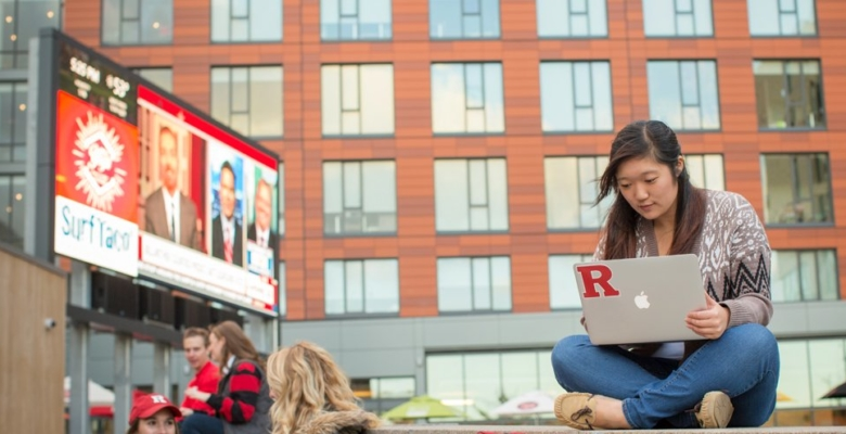 Rutgers alumna on laptop