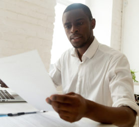 Man reviewing document