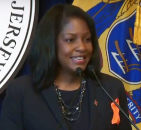 Photo of Fabiana Pierre Louis speaking