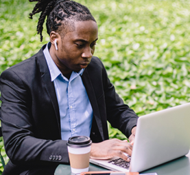 african american man working with a laptop