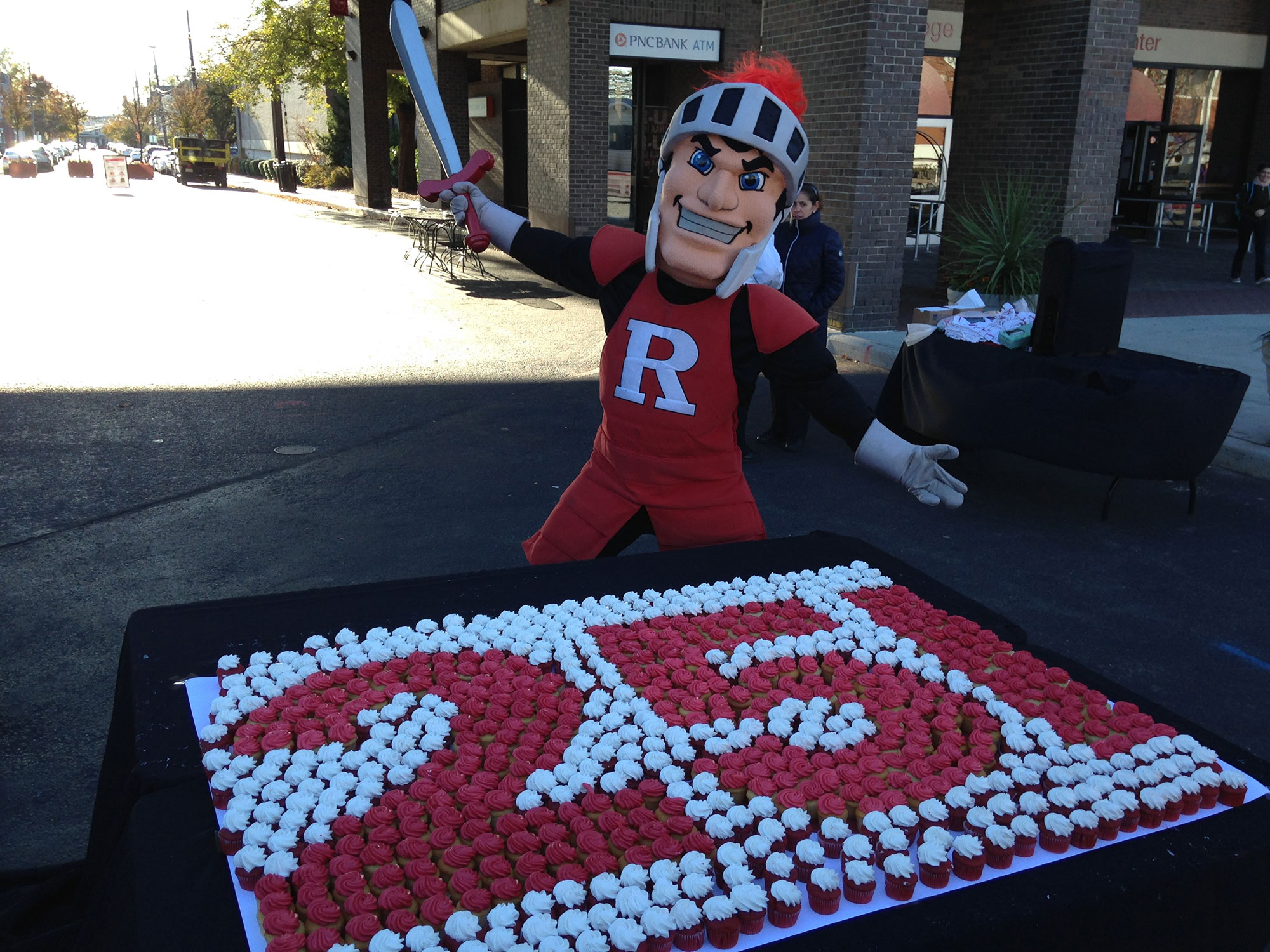 photo of rutgers mascot with cupcakes forming the number 25