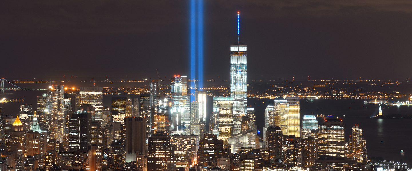 """New York City skyline with """"Tribute of Light"""" art installation shining a beacon of light where theTwin Towers used to stand"""