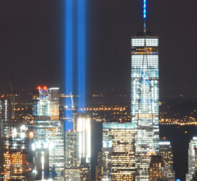 "Never Forgotten: New York City skyline with ""Tribute of Light"" art installation shining a beacon of light where theTwin Towers used to stand"