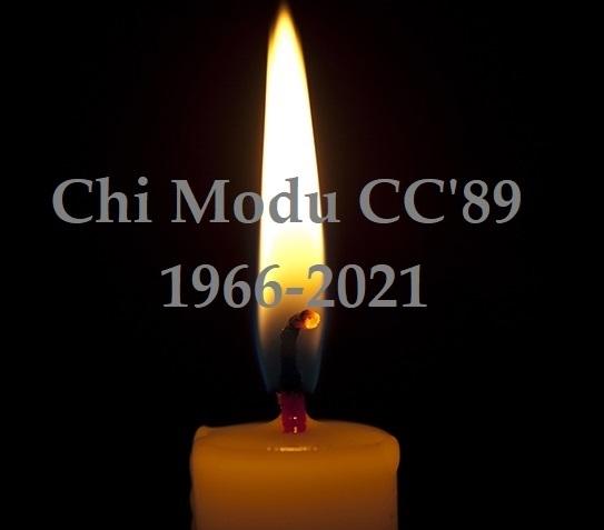 Horizontal photo of lighted candle isolated on black background.